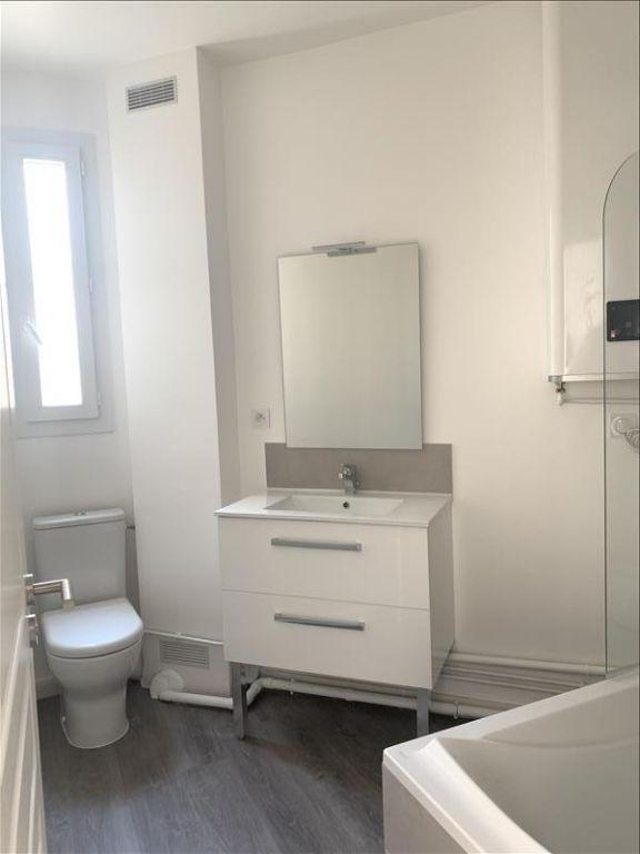 Rental apartment Paris 18ème 1125€ CC - Picture 4