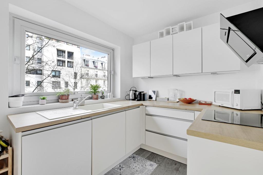Vente appartement Paris 11ème 699000€ - Photo 5
