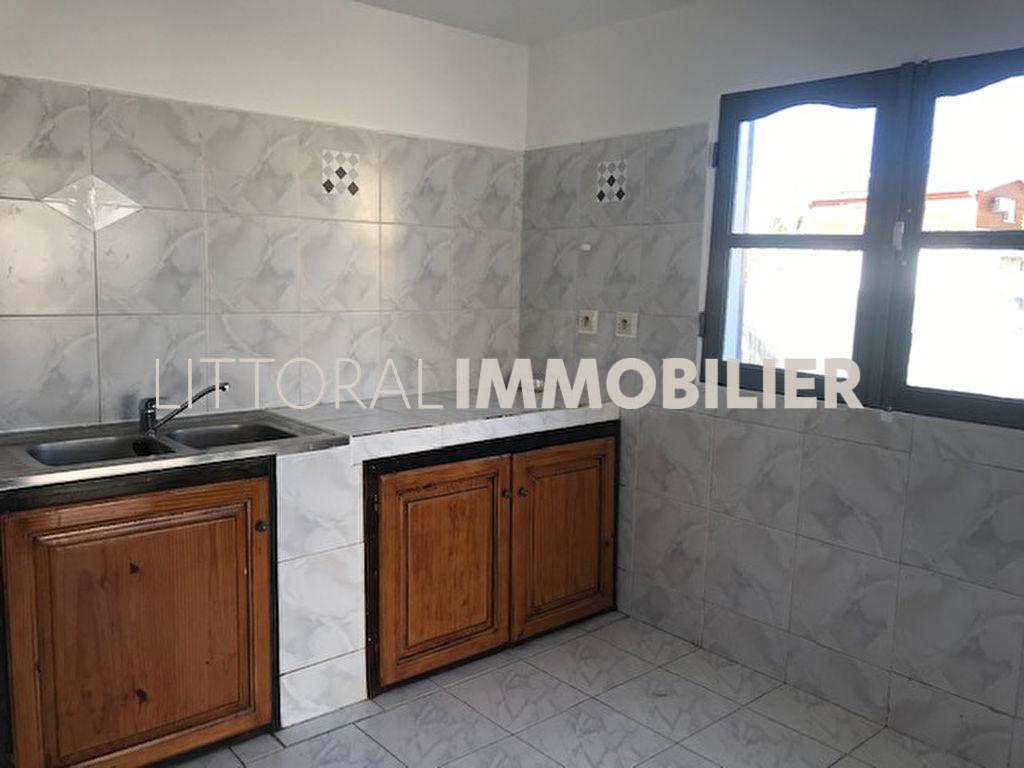 Rental apartment Saint gilles les bains 950€ CC - Picture 4
